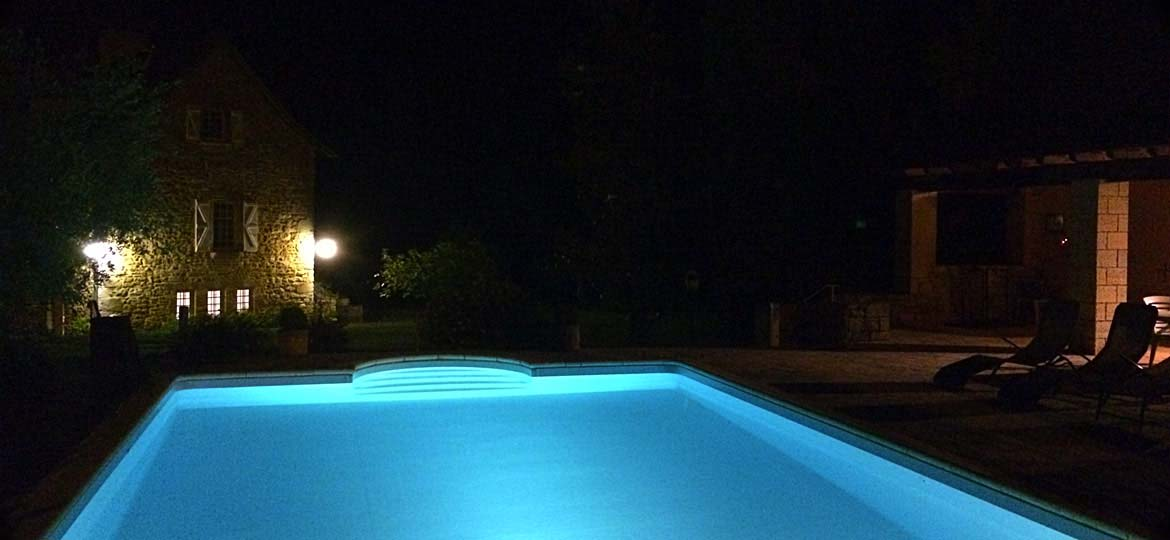 The Moulin du Boisset swimming pool area by night